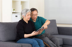 Senior couple using tablet computer Stock Images