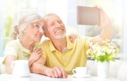Senior couple using tablet. Portrait of a happy senior couple using digital tablet Royalty Free Stock Images