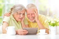 Senior couple using tablet. Portrait of happy senior couple using digital tablet Stock Photography