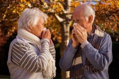 Senior couple using tissues Royalty Free Stock Photography
