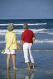 Senior couple on vacation. Senior couple holding hands on the beach Stock Photography