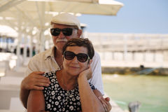 Senior couple on vacation. Standing near the sea Stock Photo