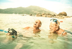 Senior couple vacationer having genuine fun on tropical beach. Senior couple vacationer having genuine fun on tropical Koh Lipe sea in Thailand - Snorkel tour in royalty free stock photos