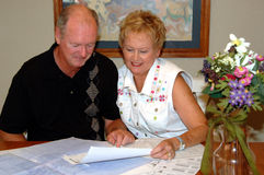 Senior couple viewing house plans Royalty Free Stock Photo