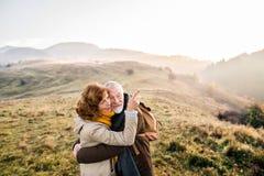 Senior couple on a walk in an autumn nature. Royalty Free Stock Photos