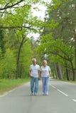 Senior couple walk Stock Images
