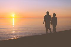 Senior couple walking along the beach Stock Photography