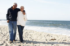 Senior Couple Walking Along Beach Together royalty free stock photos