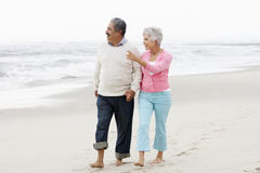 Senior Couple Walking Along Beach Together Royalty Free Stock Image