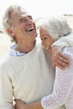 Senior Couple Walking Along Beach Together Stock Photos