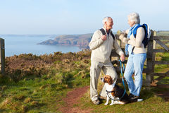Senior Couple Walking Along Coastal Path Stock Image