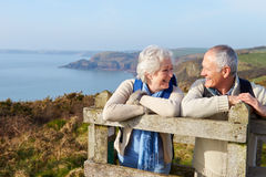Senior Couple Walking Along Coastal Path Stock Images