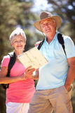 Senior couple walking along a country road Stock Photo