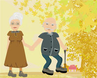 Senior couple walking in autumn day Stock Photos