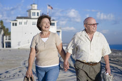 Senior Couple Walking On Beach Royalty Free Stock Photo