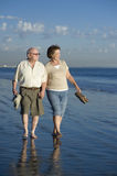Senior Couple Walking On Beach Royalty Free Stock Image