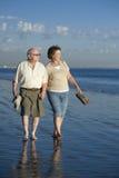 Senior Couple Walking On Beach Royalty Free Stock Image