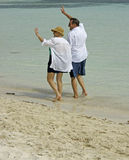 Senior couple walking beach Stock Images