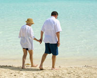 Senior couple walking on beach Stock Photo