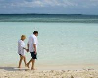 Senior couple walking on beach. Senior couple walking on the beach Stock Image