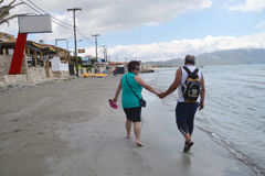 Senior couple walking on beach Royalty Free Stock Photos
