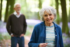Senior Couple Walking Through Bluebell Woods Royalty Free Stock Photos