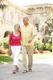 Senior Couple Walking Through City Street Royalty Free Stock Image