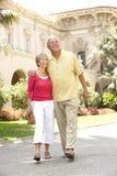 Senior Couple Walking Through City Street Royalty Free Stock Photography