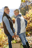 Senior couple walking in forest in automn season Royalty Free Stock Images
