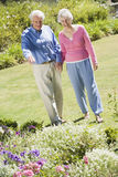 Senior couple walking in garden Royalty Free Stock Photo