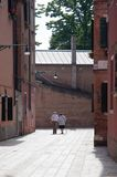 Senior couple walking with hand to hand in Venice - Health concept - style life & activity stock photo
