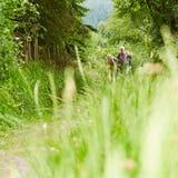 Senior couple walking on hiking trail Stock Images