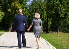 Free Senior Couple Walking In Summer In Park Royalty Free Stock Photography - 143242447
