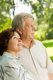 Senior couple walking outdoors Royalty Free Stock Images