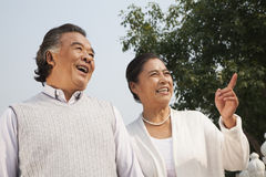 Senior couple walking outdoors and pointing in Beijing Stock Photo