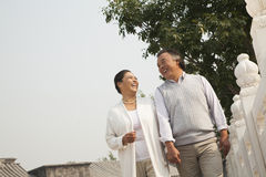 Senior couple walking outside in Beijing, tilt Royalty Free Stock Photos