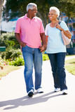 Senior Couple Walking In Park Together Stock Photos