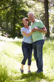 Senior Couple Walking In Summer Countryside Royalty Free Stock Photo