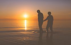 Senior couple walking at sunset Royalty Free Stock Photos