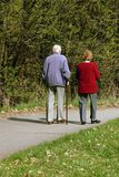 Senior Couple Walking Together. Old couple walking together in park Royalty Free Stock Images