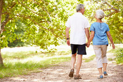 Free Senior Couple Walking Together In The Countryside, Back View Stock Photo - 59874760