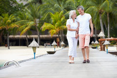 Senior Couple Walking On Wooden Jetty Stock Photography