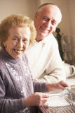 Senior Couple Washing Up At Sink Stock Photography