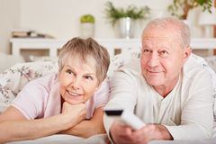 Senior couple watch TV for leisure. And relaxation in their free time Stock Images