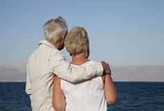 Senior couple watching the sea Stock Photography