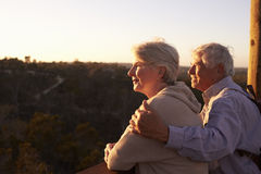 Senior Couple Watching Sunset From Observation Deck Stock Photos