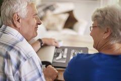 Senior couple watching their old photos Royalty Free Stock Photos