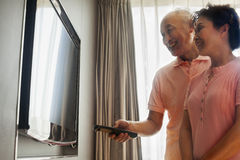 Senior couple watching TV Stock Images