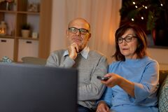 Free Senior Couple Watching Tv At Home In Evening Stock Images - 174655564