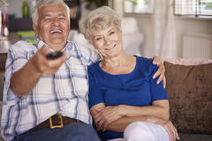 Senior couple watching TV Stock Image